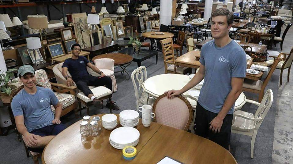 From left, Griffin Amdur, Andrew Witherspoon and James McPhail started a charity that provides furniture for people in need. Their Chicago Furniture Bank has corporate partners such as Walter E. Smithe Furniture and Design of Itasca.