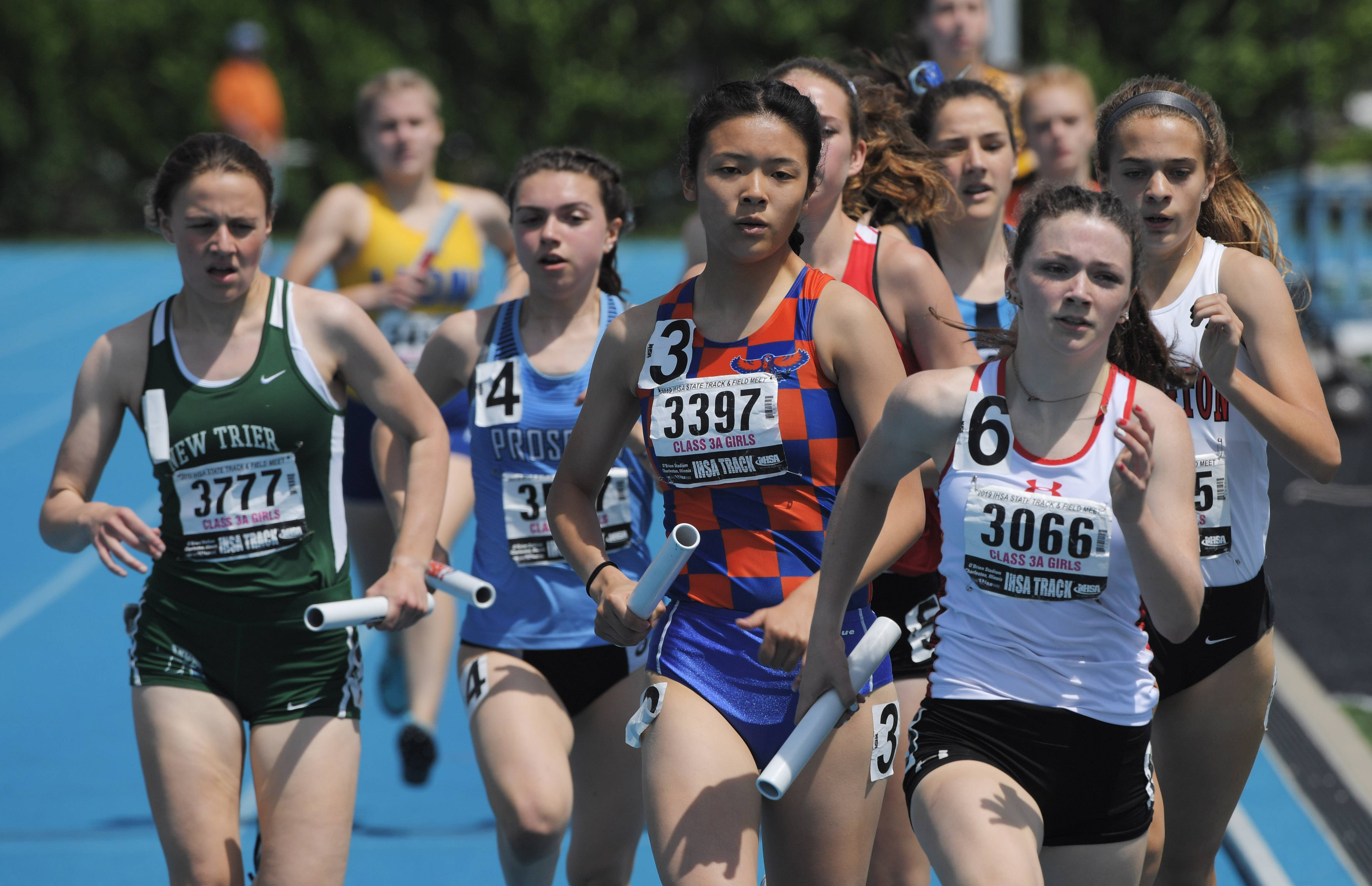 Batavia's Katrina Schlenker (3066) leads the field midway through the Class 3A 3,200-meter relay as Hoffman Estates' Nikki Rong (3397) runs just behind her during the girls state track finals in Charleston Saturday.