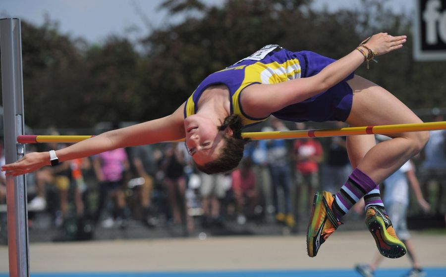 Wauconda's Grace Daun clears the bar in the Class 3A high jump during the girls state track finals in Charleston Saturday.