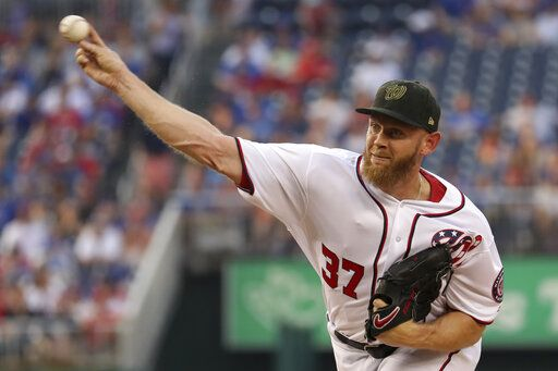 Washington Nationals starting pitcher Stephen Strasburg throws during the first inning of the team's baseball game against the Chicago Cubs, Saturday, May 18, 2019, in Washington.