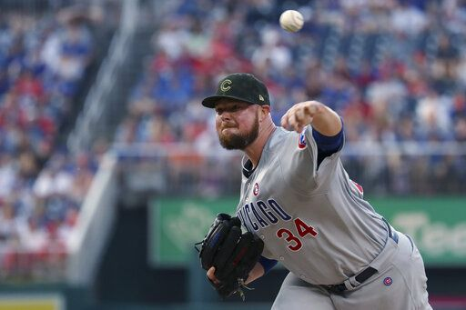Chicago Cubs starting pitcher Jon Lester throws during the first inning of the team's baseball game against the Washington Nationals, Saturday, May 18, 2019, in Washington.