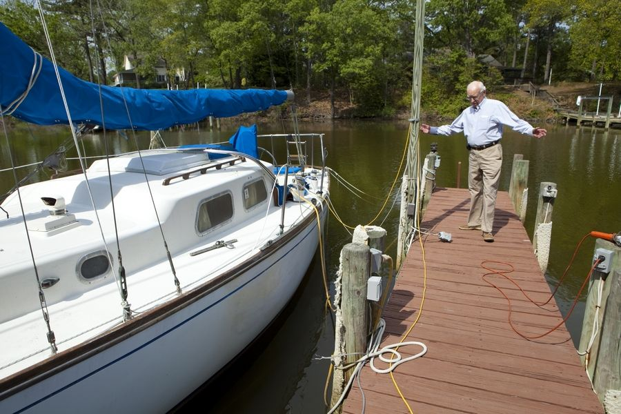 Former newspaper reporter Gordon Eliot White, 85, lives in Deltaville, Va., near the Chesapeake Bay. He relaxes by sailing a half-century-old sailboat he keeps docked at the edge of his yard.