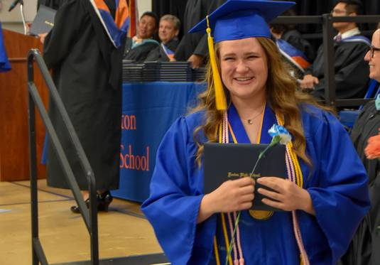 Jessica Jalowiec with her diploma at the Fenton High School graduation on Sunday at the school.