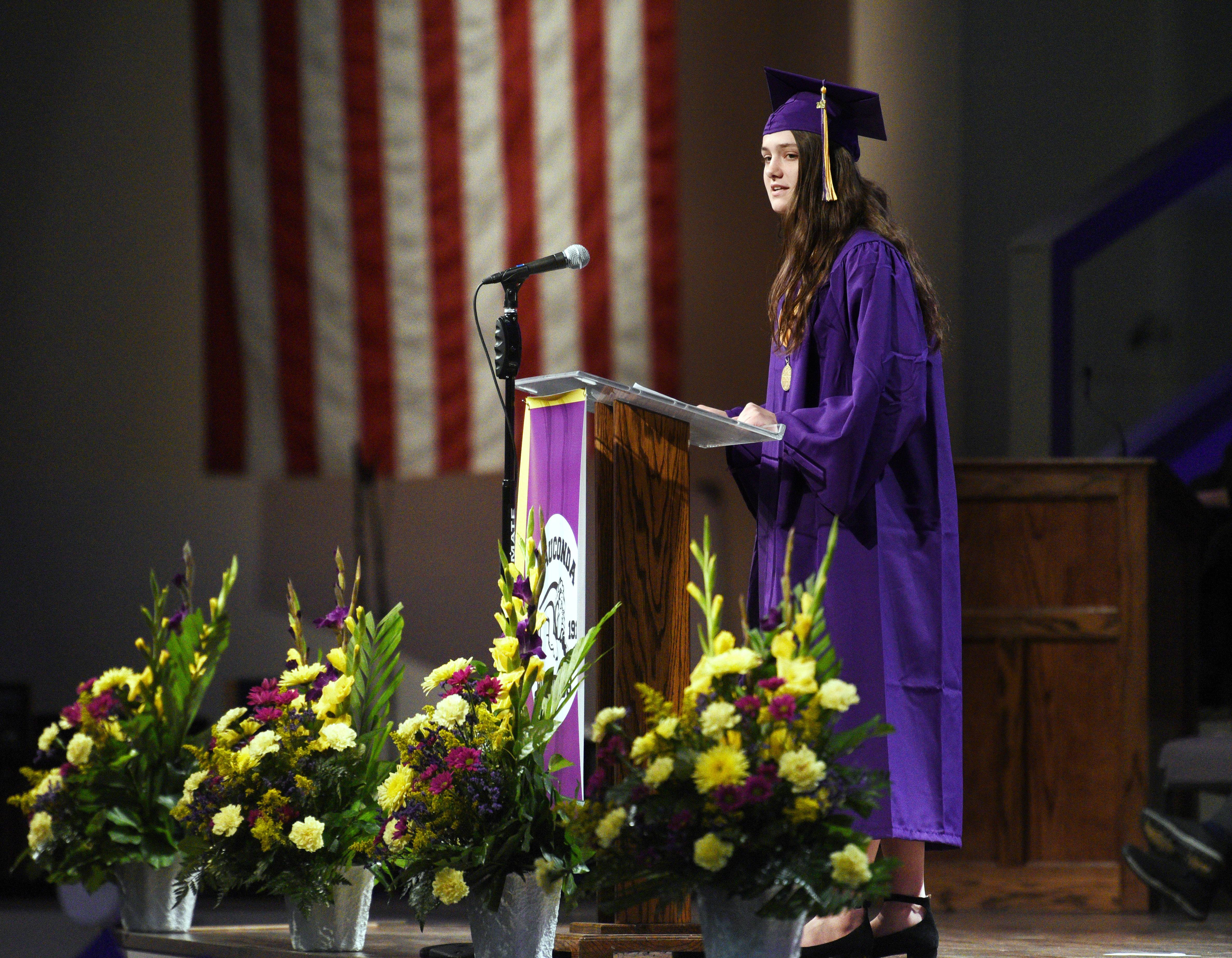 Wauconda High School student speaker Kelly Kroegel addresses the crowd during the school's graduation ceremony Sunday at Quentin Road Baptist Church in Lake Zurich.