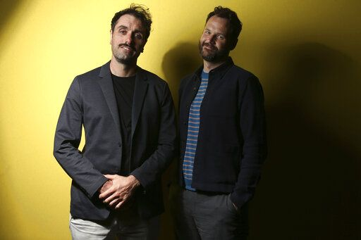 Writer/director Michael Angelo Covino, left, and actor Kyle Marvin pose for portrait photographs for the film 'The Climb' at the 72nd international film festival, Cannes, southern France, Saturday, May 18, 2019. (Photo by Joel C Ryan/Invision/AP)