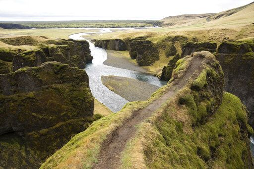 "This photo taken Wednesday, May 1, 2019, shows a cliff at the Fjadrárgljúfur canyon in southeastern Iceland. The canyon area has suffered environmental damages after intense traffic, prompted by the music video ""I'll Show You"" by Justin Bieber."