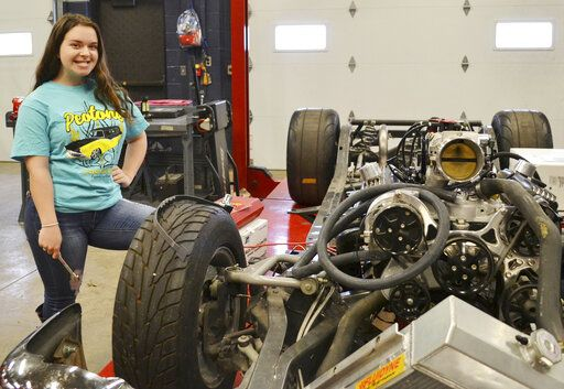 Angelle Vanderwarf, a senior cheerleader at Beecher High School, is a leader in the automotive technology program at the Kankakee Area Career Center. Her leadership has led to several career offers, and she was named a finalist in a national contest. (Laura McElroy/The Daily Journal via AP)