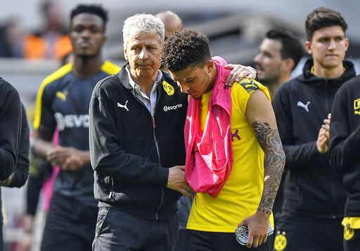 Dortmund coach Lucien Favre comforts Dortmund's Jadon Sancho after the German Bundesliga soccer match between Borussia Moenchengladbach and Borussia Dortmund in Moenchengladbach, Germany, Saturday, May 18, 2019. Dortmund finished the season on the second place behind Bayern Munich.