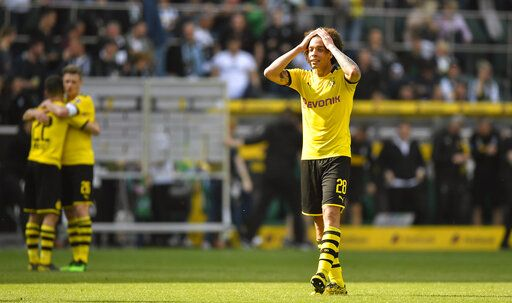 Dortmund's Axel Witsel reacts after the German Bundesliga soccer match between Borussia Moenchengladbach and Borussia Dortmund in Moenchengladbach, Germany, Saturday, May 18, 2019. Dortmund finished the season on the second place behind Bayern Munich.