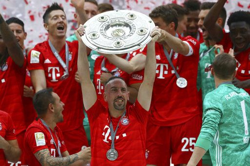 CORRECTS NAME OF OPPONENT TEAM -- Bayern's Franck Ribery lifts the trophy to celebrate Bayern's 7th straight Bundesliga title after the German Soccer Bundesliga match between FC Bayern Munich and Eintracht Frankfurt in Munich, Germany, Saturday, May 18, 2019.