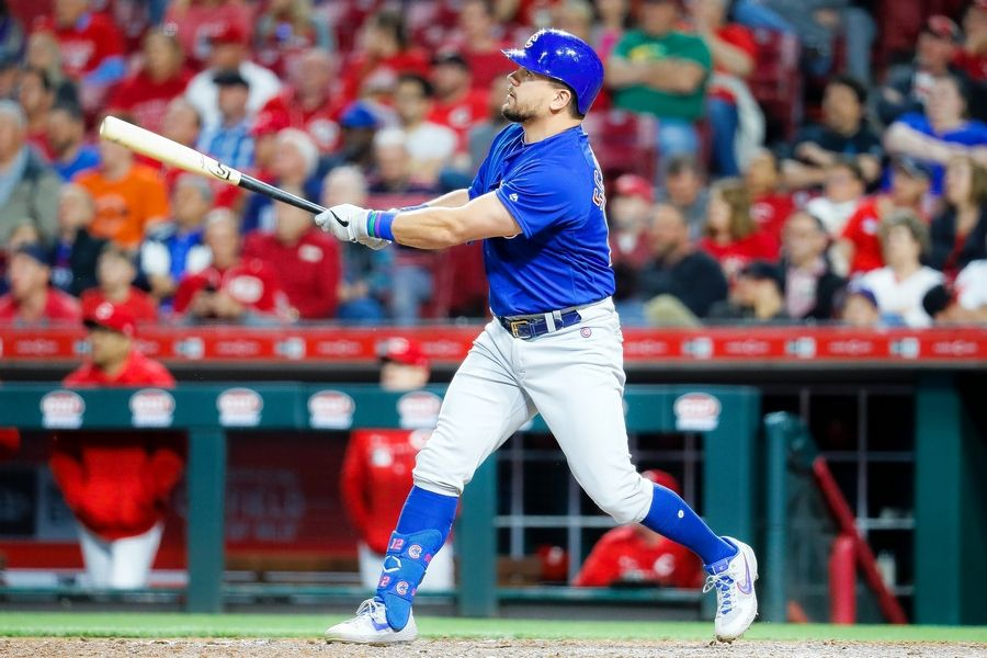 Cubs left fielder Kyle Schwarber hits a solo home run off Reds relief pitcher David Hernandez in the eighth inning Wednesday in Cincinnati.