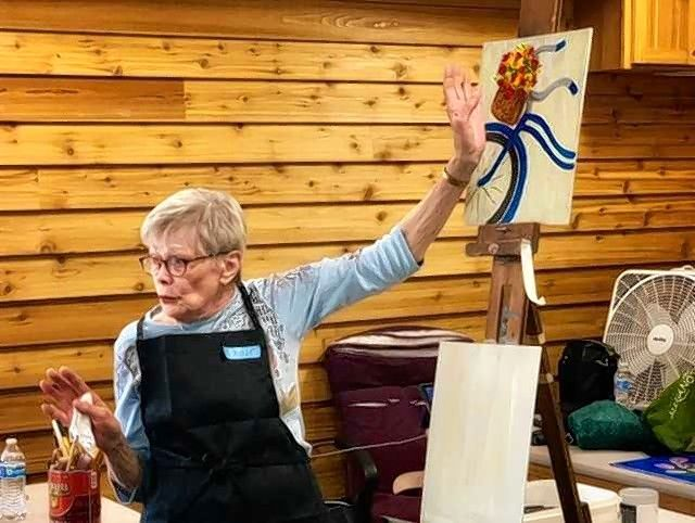 The Des Plaines Art Guild will hold a Paint 'n' Sip party Friday, May 24, at the Lake Park Pavilion. DPAG leader Elaine Tejcek directs participants at a previous Paint 'n' Sip party.