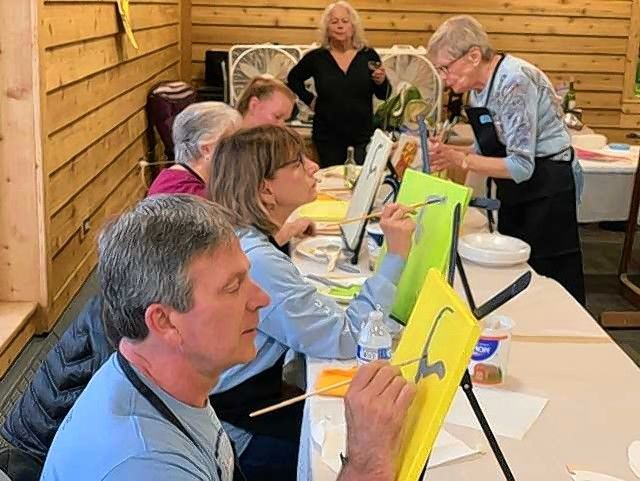 The Des Plaines Art Guild will hold a Paint 'n' Sip party Friday, May 24, at the Lake Park Pavilion. Participants begin to paint assisted by members of DPAG, at a previous party.