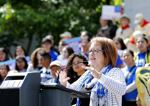 State Sen. Maria Elena Durazo, D-Los Angeles, addresses a gathering at the Immigrants Day of Action rally, Monday, May 20, 2019, in Sacramento, Calif. Gov. Gavin Newsom has proposed offering government-funded health care benefits to immigrant adults ages 19 to 25 who are living in the country illegally. Durazo, has proposed a bill to expand that further to include seniors age 65 and older.