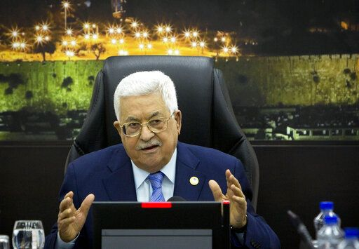FILE - In this April 29, 2019, file photo, Palestinian President Mahmoud Abbas, center, chairs a session of the weekly cabinet meeting in the West Bank city of Ramallah. The Trump administration will unveil the first phase of its long-awaited blueprint for Mideast peace next month at a conference in the region designed to highlight economic benefits that could be reaped if the Israeli-Palestinian conflict is resolved, the White House said Sunday, May 19. Jared Kushner and Jason Greenblatt, envoy of international negotiations, have been leading efforts to write the plan, but so far, there's been no participation from the Palestinians.