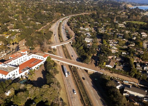 FILE - This Jan. 22, 2018 file photo from a news agency drone shows U.S. Highway 101 open to vehicle traffic in Montecito, Calif., after heavy rain brought flash flooding and mudslides that covered the highway two weeks earlier. In Utah, drones are hovering near avalanches to measure roaring snow. In North Carolina, they're combing the skies for the nests of endangered birds. In Kansas, meanwhile, they could soon be identifying sick cows through heat signatures. A survey released Monday, May 20, 2019 shows transportation agencies are using drones in nearly every U.S. state.