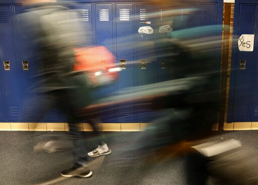 "Students walk through a hallway at Cadillac High School in Cadillac, Mich., on Wednesday, April 17, 2019. The topic of consent for sexual activity - including the age when a student can legally say ""yes"" to sexual activity - has been a frequent matter of discussion in freshman health classes here in the #MeToo era. The legal age of consent in the state Michigan is 16."