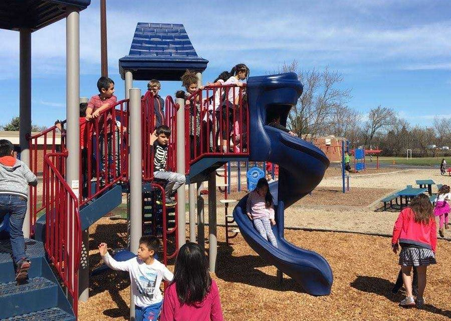 Students use new playground equipment at Diamond Lake School.