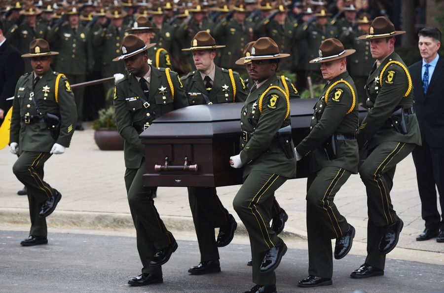 Pallbearers carry the casket of Illinois State Police Trooper Christopher Lambert during his funeral in January at Willow Creek Community Church in South Barrington. Lambert was struck and killed by a vehicle after he stopped to assist people involved in a three-car crash on the Tri-State Tollway near Northbrook.