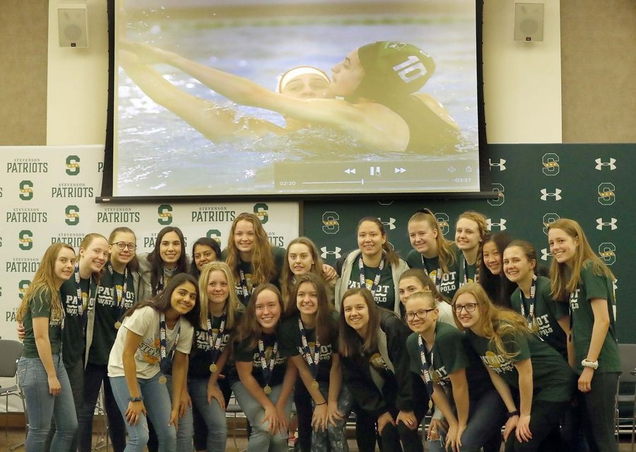 Stevenson High School honored state-title winning athletes from two sports on Tuesday morning before school. The girls water polo team won its third consecutive state championship, while Jenny Yang and Emily Hu (not pictured) are state badminton doubles champions.