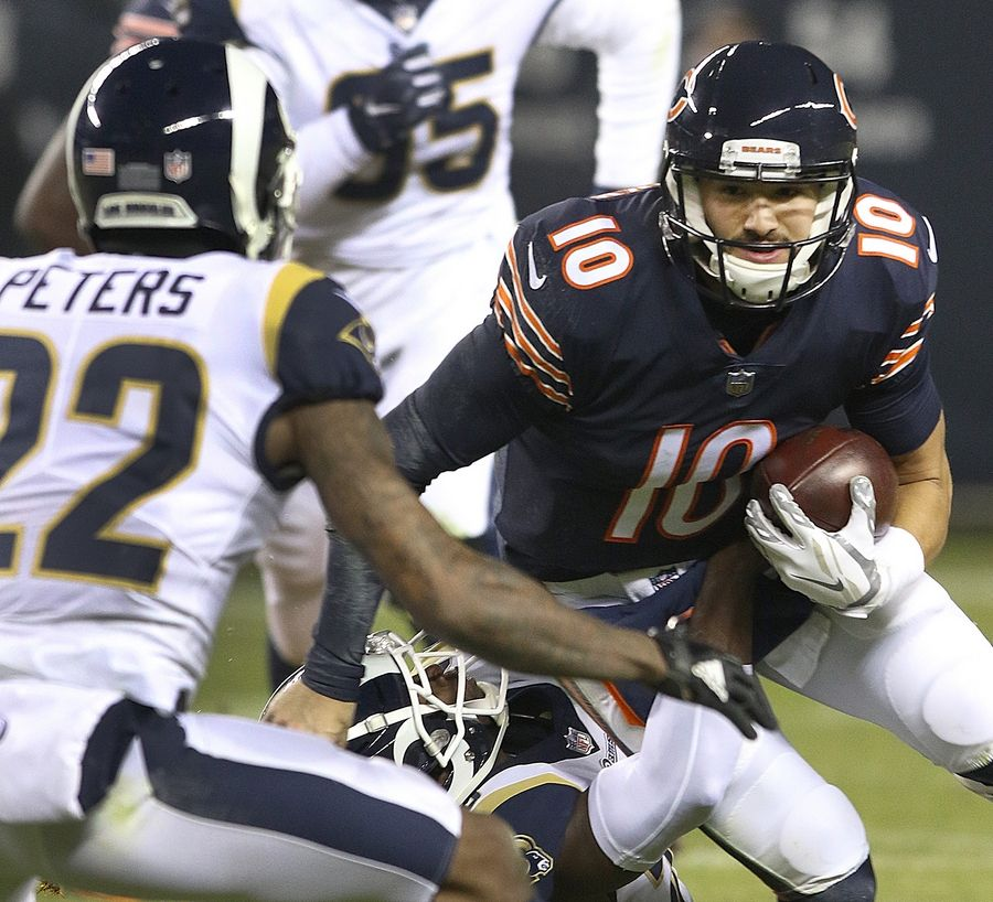 Chicago Bears quarterback Mitch Trubisky scrambles for yardage during their game against the Los Angeles Rams Sunday night at Soldier Field in Chicago.
