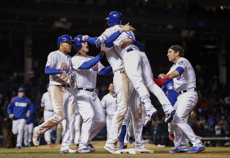 Chicago Cubs' Javier Baez (9) celebrates with teammates after hitting a game winning RBI-single against the Philadelphia Phillies during the ninth inning of a baseball game, Tuesday, May 21, 2019, in Chicago.