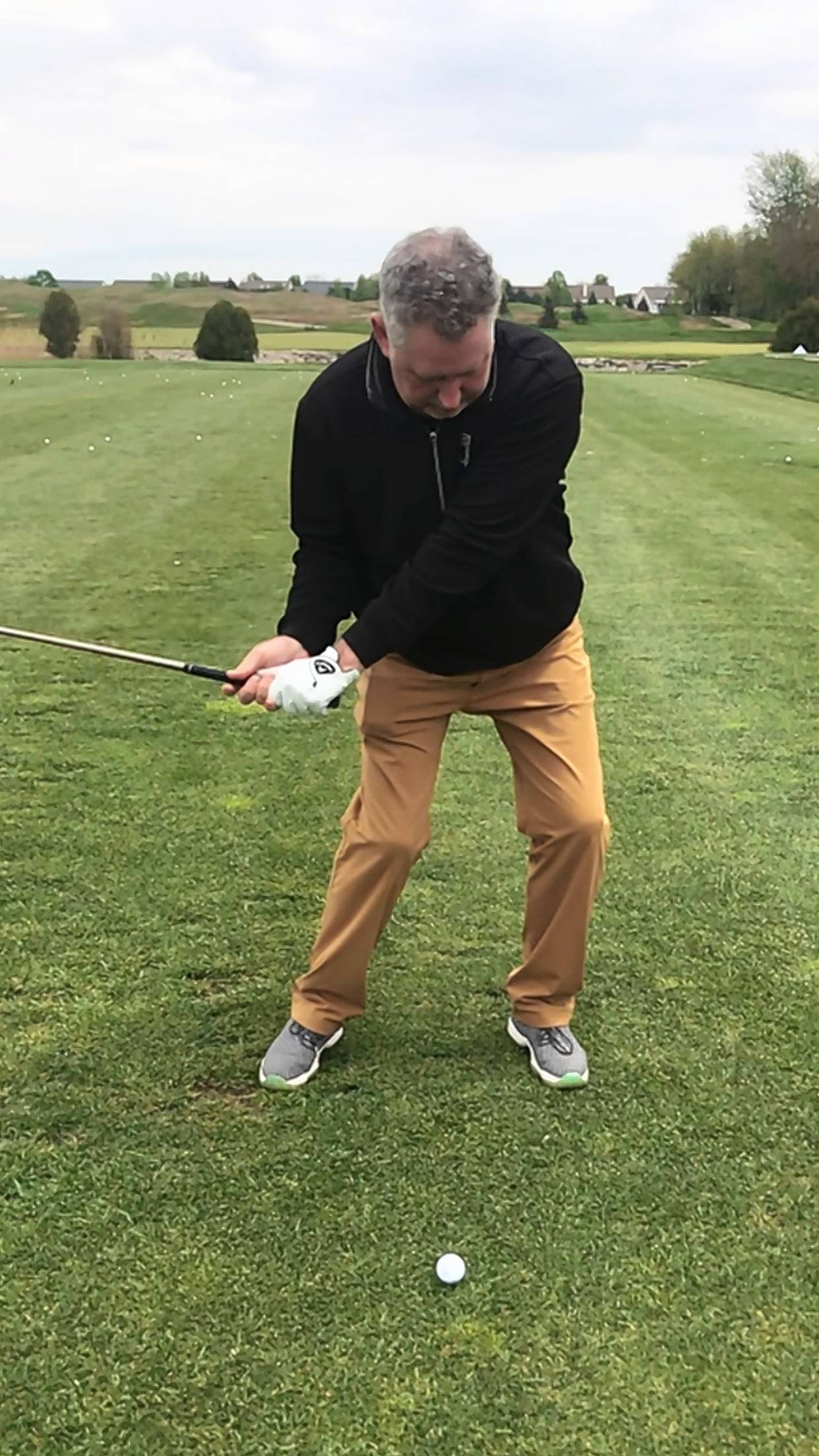 This photo shows a swing that has too much lateral movement by driving my right leg to quick toward my left leg, which created my left hip to slide and move up, thus not creating more speed just more push shots and hooks.