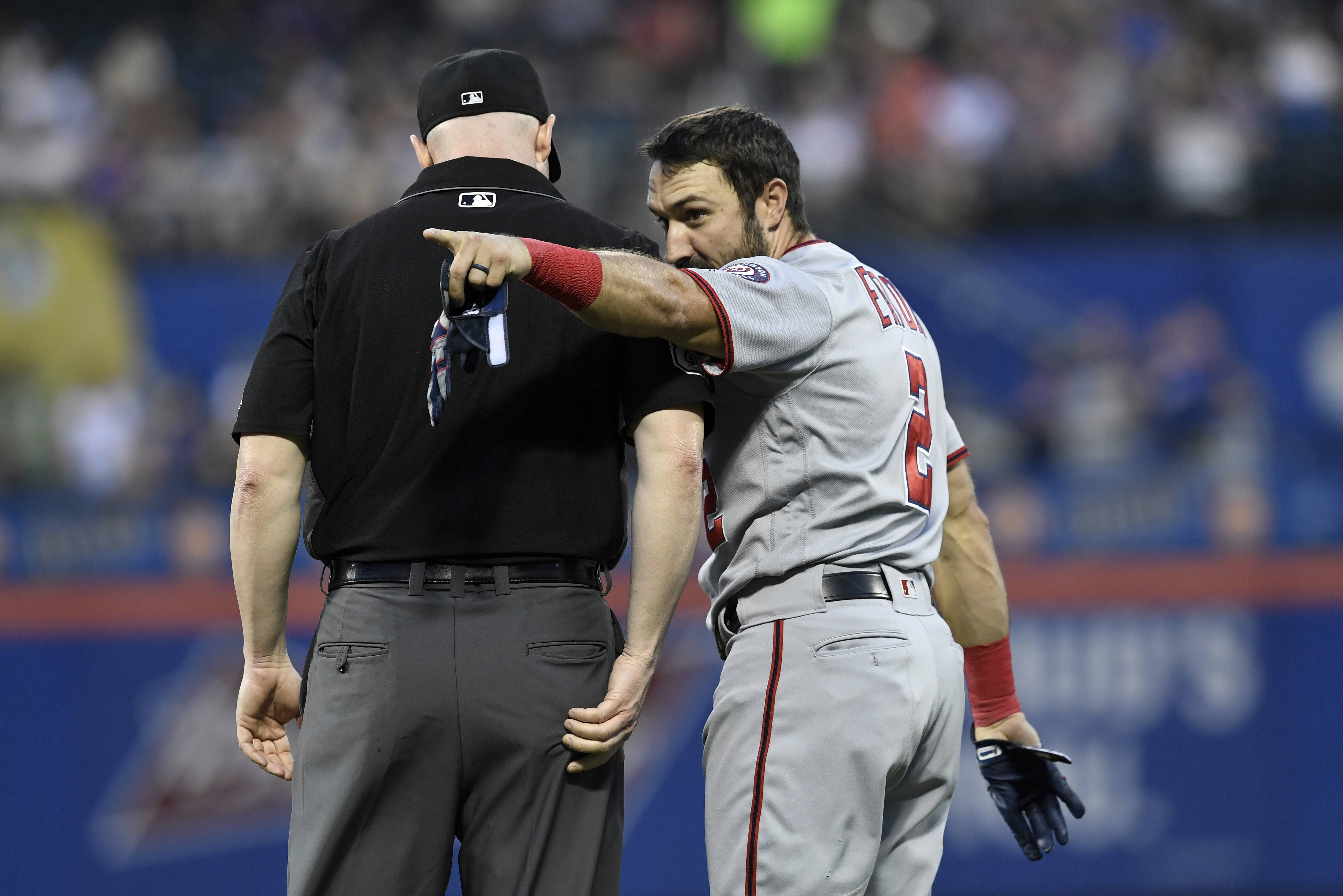Washington Nationals' Adam Eaton, right, shouts toward New York Mets third baseman Todd Frazier after a double play was turned as first base umpire Mike Estabrook, left, stands by him in a baseball game Monday, May 20, 2019, in New York. (AP Photo/Sarah Stier)