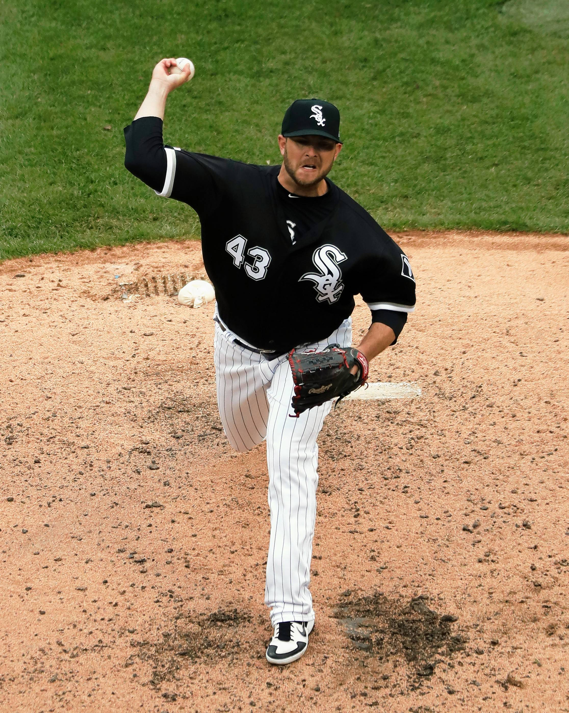 Chicago White Sox reliever Evan Marshall throws against the Baltimore Orioles during a May game. Four years after being struck in the head by a line drive, Marshall is playing with his fourth team in four years, but he knows he's lucky to be pitching at all — and lucky to be alive.