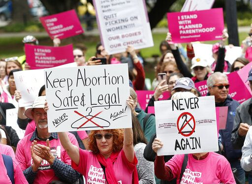 People gather at the state Capitol to rally in support of abortion rights, Tuesday, May 21, 2019, in Sacramento, Calif.