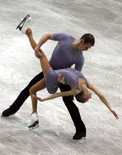 "FILE - In this Dec. 8, 2006, file photo, Bridget Namiotka and John Coughlin perform during the ISU Junior Grand Prix of Figure Skating Final in Sofia, Bulgaria. One of the former skating partners of two-time U.S. pairs champion John Coughlin has accused him in a series of social media posts of sexually assaulting her over a 2-year period. Bridget Namiotka said on Facebook that Coughlin, who died by suicide in January, hurt ""at least 10 people including me."" She skated with Coughlin from 2004, when she was 14, through the 2007 season. Namiotka's attorney confirmed to The Associated Press that the comments were made by her."