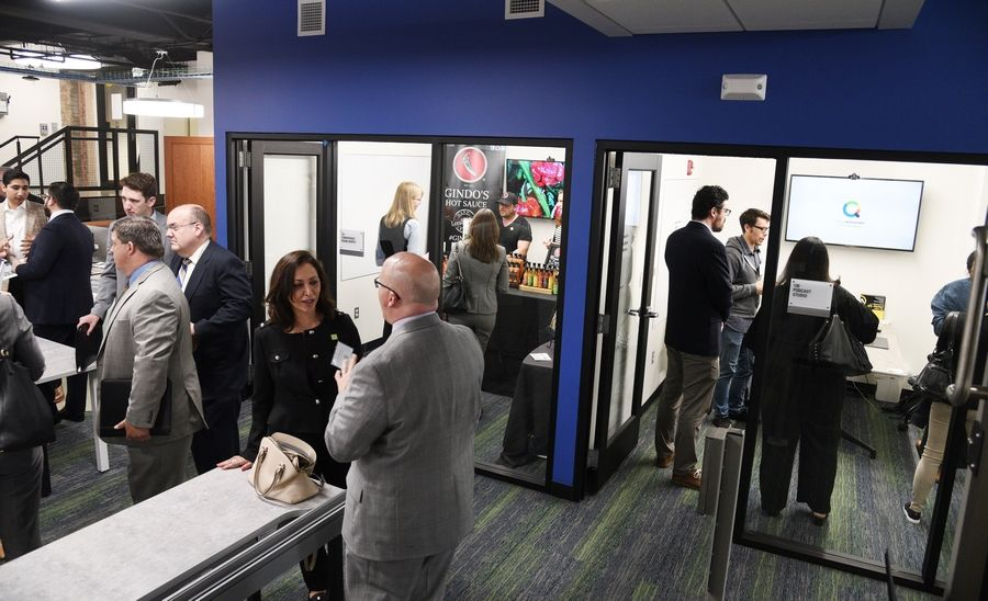 Guests tour the new headquarters of Innovation DuPage during an open house Wednesday.