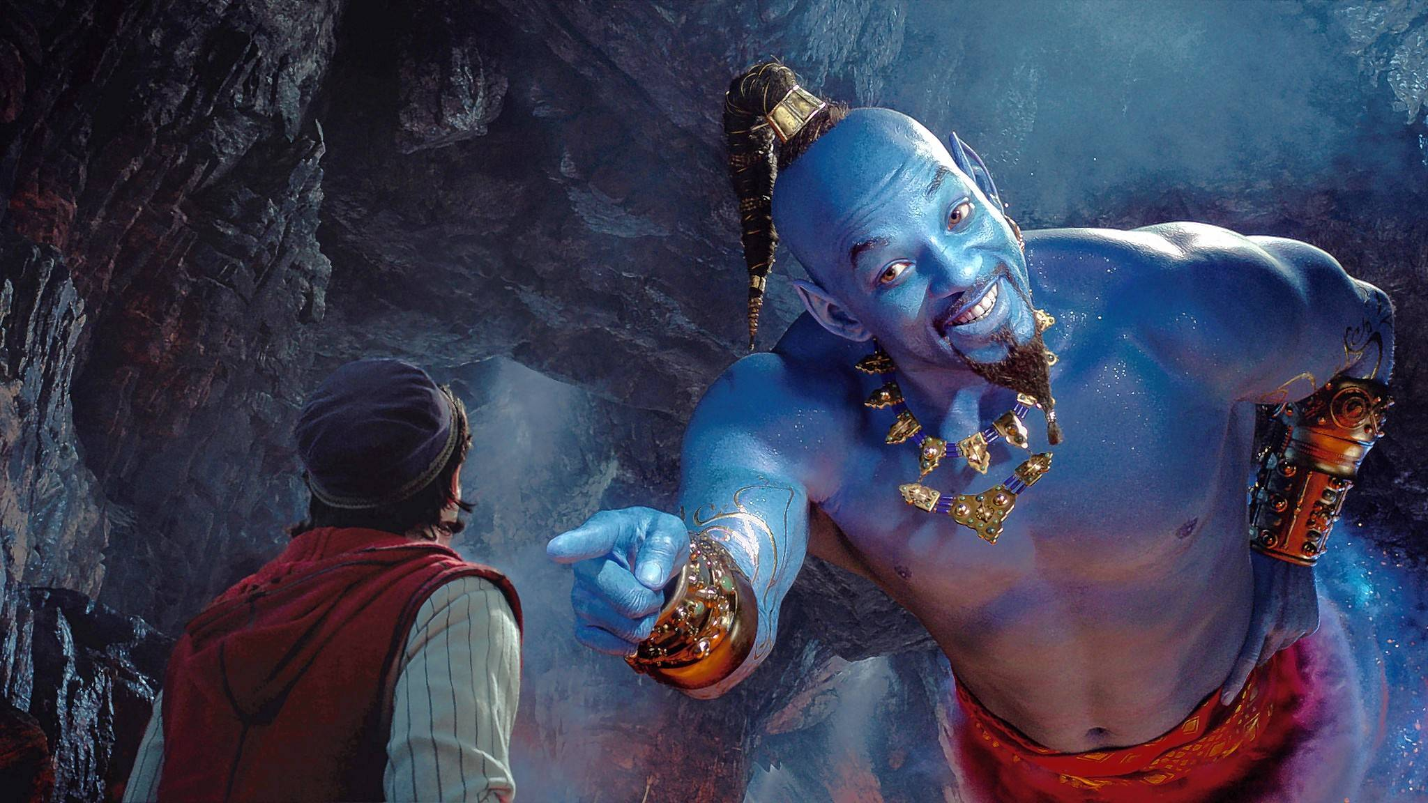 "Aladdin (Mena Massoud) meets the larger-than-life blue Genie (Will Smith) in Disney's live-action adaptation of ""Aladdin"" directed by Guy Ritchie."