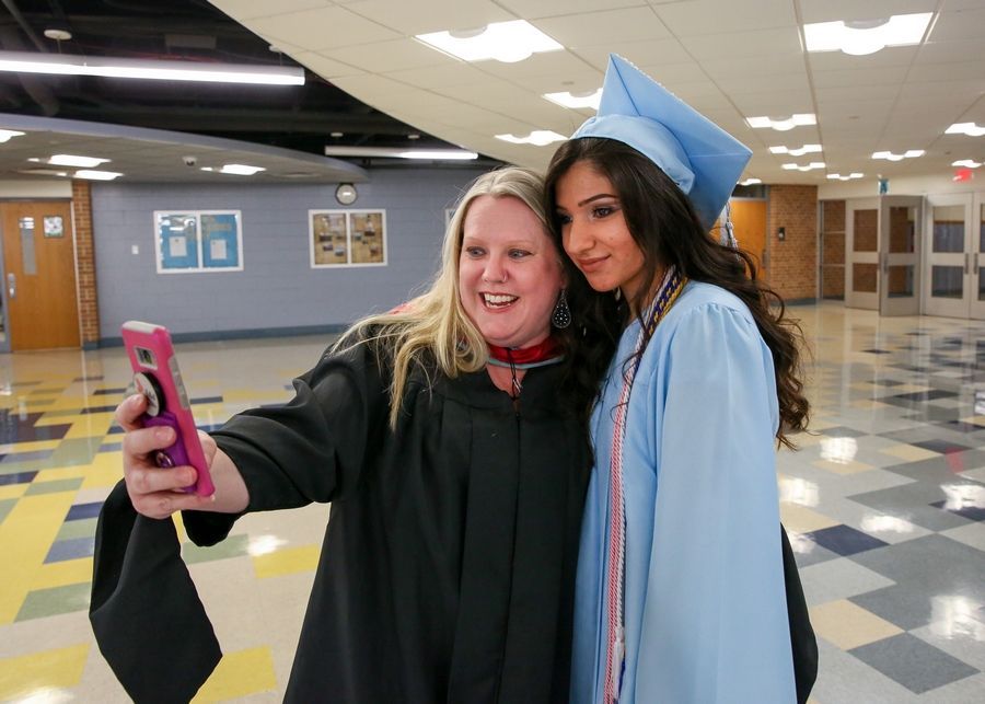 Counselor Kimberly Mikesell takes a selfie with graduate Miriam Youhanoun before Willowbrook's graduation in Villa Park.