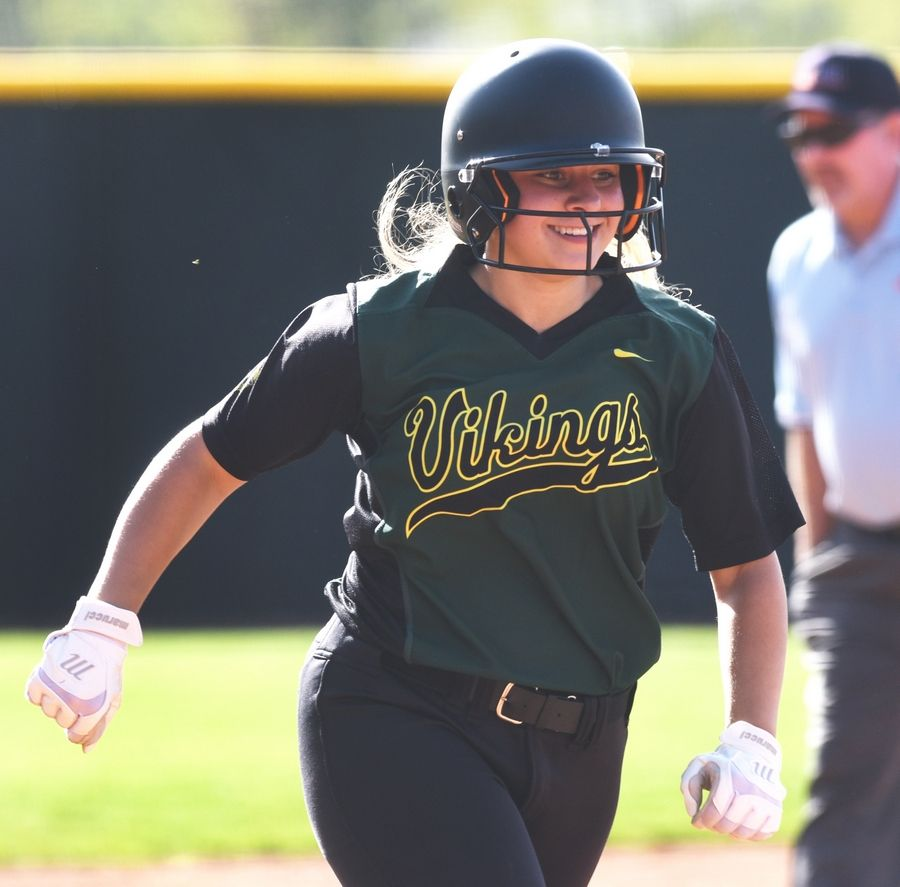 Fremd's Calista DiVito rounds the bases after hitting a third-inning grand slam against Glenbard North during Wednesday's regional semifinal softball game in Palatine.
