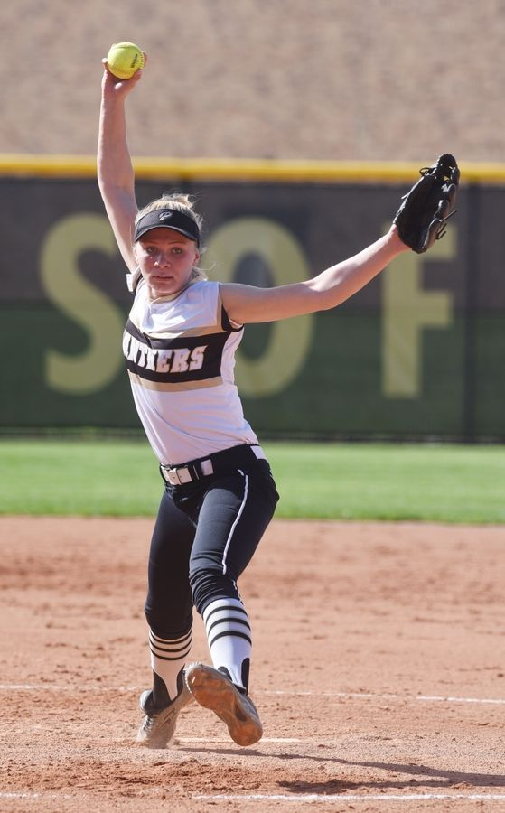 Glenbard North starting pitcher Kaitlyn Schietler delivers during Wednesday's regional semifinal softball game against Fremd.