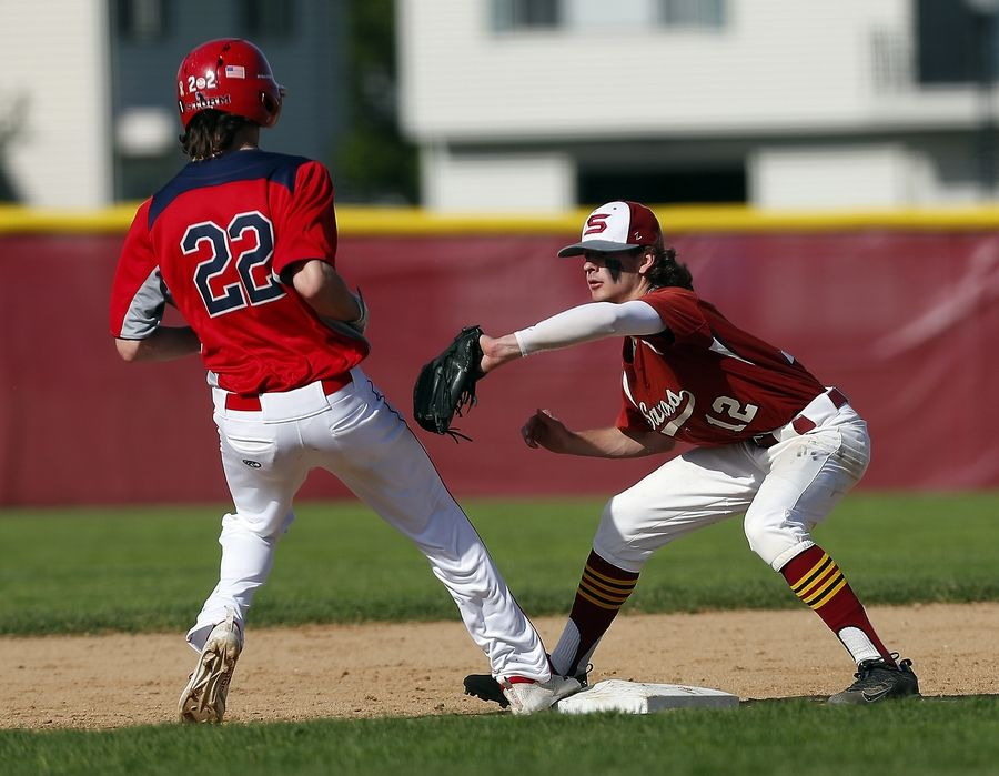 Schaumburg's Vince D'Orazio (12) tries to put the tag on South Elgin's Austin Doty (22) at second base Wednesday during the Class 4A Schaumburg baseball regional semifinals.