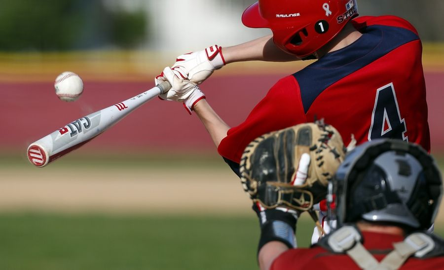 South Elgin's Grayson Downing (4) makes contact on a Schaumburg pitch Wednesday during the Class 4A Schaumburg baseball regional semifinals.
