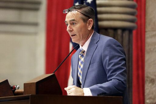 FILE - In this May 1, 2019 file photo, House Speaker Glen Casada, R-Franklin, stands at the microphone during a House session in Nashville, Tenn. Casada announced Tuesday, May 21, 2019 he plans to resign from his leadership post following a vote of no confidence by his Republican caucus amid a scandal over explicit text messages.