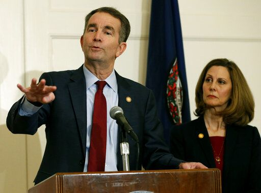 FILE - In this Feb. 2, 2019 file photo, Virginia Gov. Ralph Northam, left, gestures as his wife, Pam, listens during a news conference in the Governors Mansion at the Capitol in Richmond, Va. A law firm has completed its investigation into how a racist photo appeared on a yearbook page for Northam. Eastern Virginia Medical School said in a statement Tuesday, May 21 that the findings of the investigation will be announced at a press conference on Wednesday, May 22. Northam's profile in the 1984 yearbook includes a photo of a man in blackface standing next to someone in Ku Klux Klan clothing. Northam denies being in the photo, which nearly ended his political career in February.