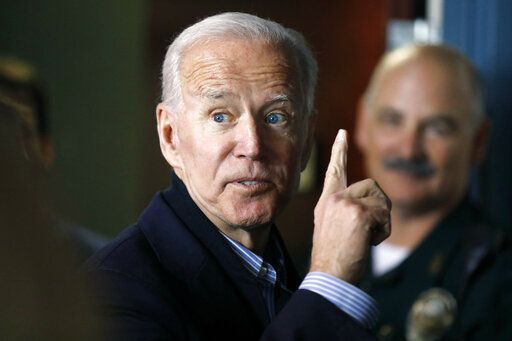 "In this May 13, 2019, photo, former vice president and Democratic presidential candidate Joe Biden interacts with a supporter during a campaign stop at the Community Oven restaurant in Hampton, N.H.  North Korea has labeled Biden a ""fool of low IQ"" and an ""imbecile bereft of elementary quality as a human being"" after the Democratic presidential hopeful during a recent speech called North Korean leader Kim Jong Un a tyrant."