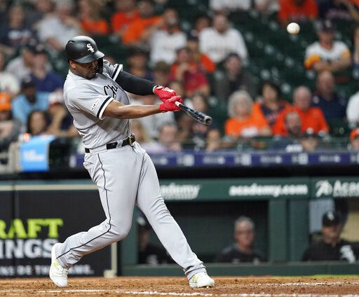 Chicago White Sox's Eloy Jimenez hits a home run against the Houston Astros during the eighth inning of a baseball game Wednesday, May 22, 2019, in Houston.