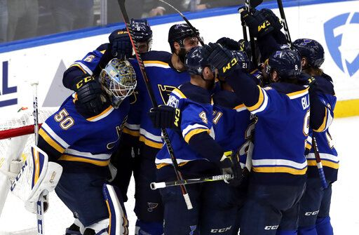 Members of the St. Louis Blues celebrate after defeating the San Jose Sharks 5-1 in Game 6 of the NHL hockey Stanley Cup Western Conference final series Tuesday, May 21, 2019, in St. Louis.