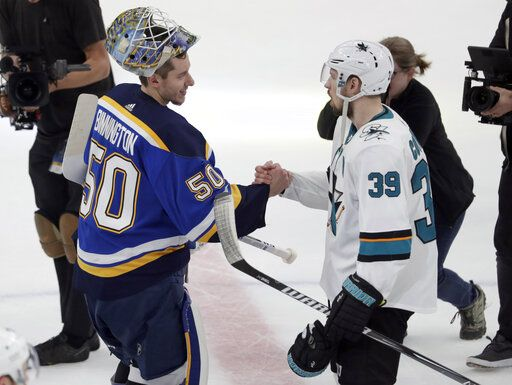 St. Louis Blues goaltender Jordan Binnington (50) and San Jose Sharks' Logan Couture (39) shake hands following Game 6 of the NHL hockey Stanley Cup Western Conference final series Tuesday, May 21, 2019, in St. Louis. The Blues won the game 5-1 to take the series 4-2.