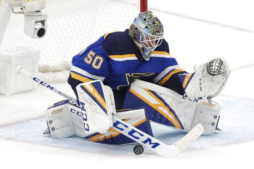 St. Louis Blues goaltender Jordan Binnington blocks a shot against the San Jose Sharks during the third period in Game 6 of the NHL hockey Stanley Cup Western Conference final series Tuesday, May 21, 2019, in St. Louis.