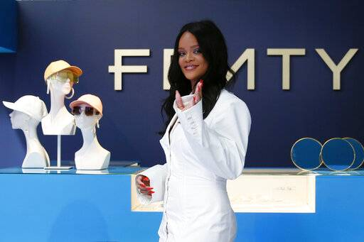 Singer Rihanna, the first black woman in history to head up a major Parisian luxury house, poses as she unveiled her first fashion designs for Fenty at a pop-up store in Paris Wednesday, May 22.