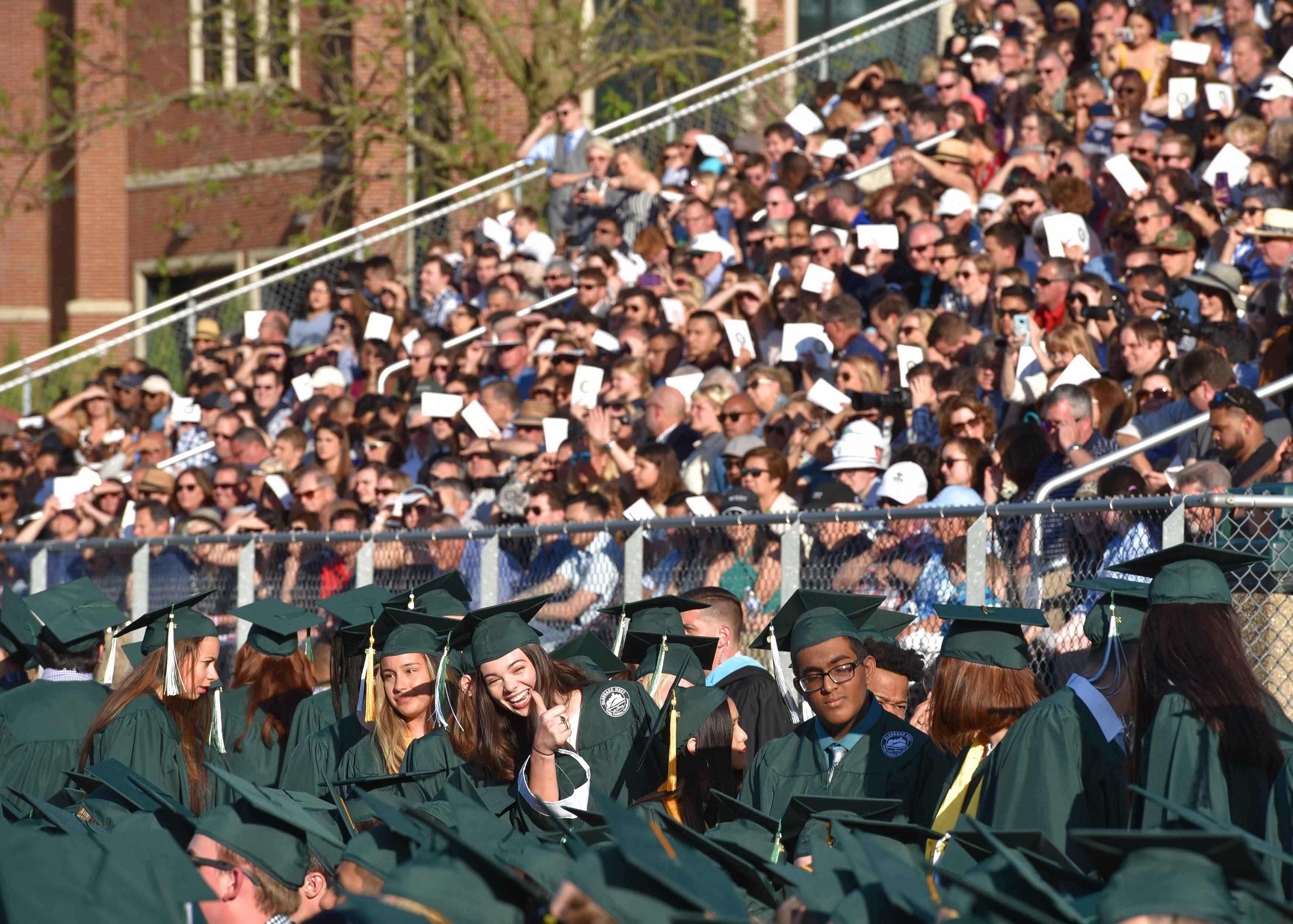 Almost 600 graduates and their families filled the football stadium at the Glenbard West High School graduation ceremony Thursday at the school in Glen Ellyn.