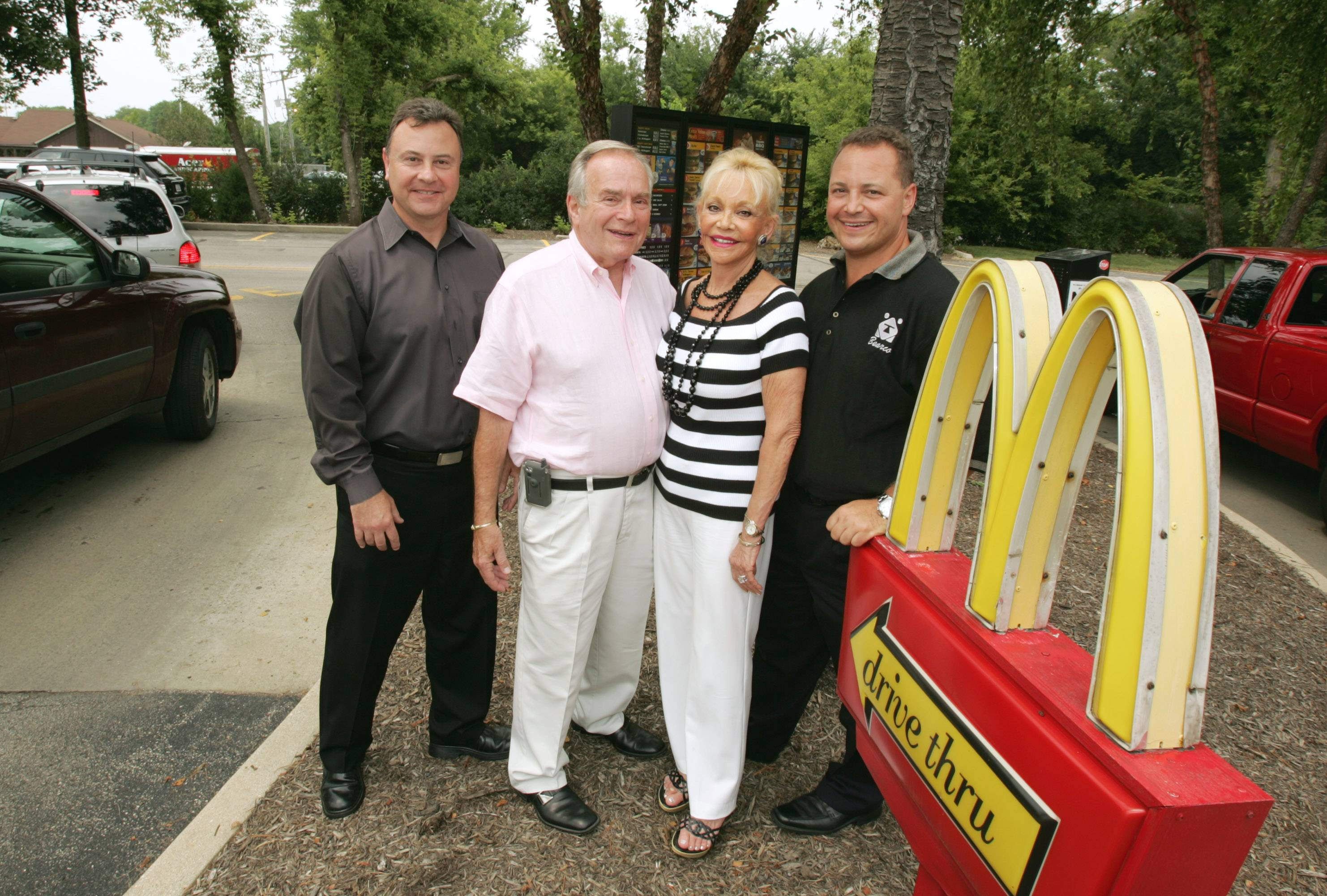 "This photo from 2008 shows Gerald ""Jerry"" Bear, second from left, next to his wife, Marcelle, and their sons, Marc Bear, far left, and David Bear, far right. Jerry died Friday. The Bear family owns 32 McDonald's in the suburbs and started in 1967 with one in Elgin."