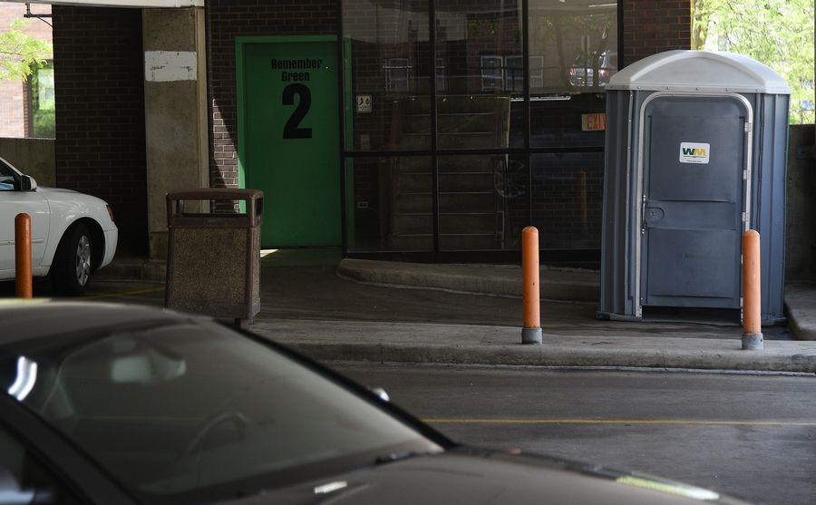 Elgin City Council members endorsed a city hall plan to tighten rules about private property left in public spaces. The city this week also installed two portable toilets in downtown parking garages, shown here.