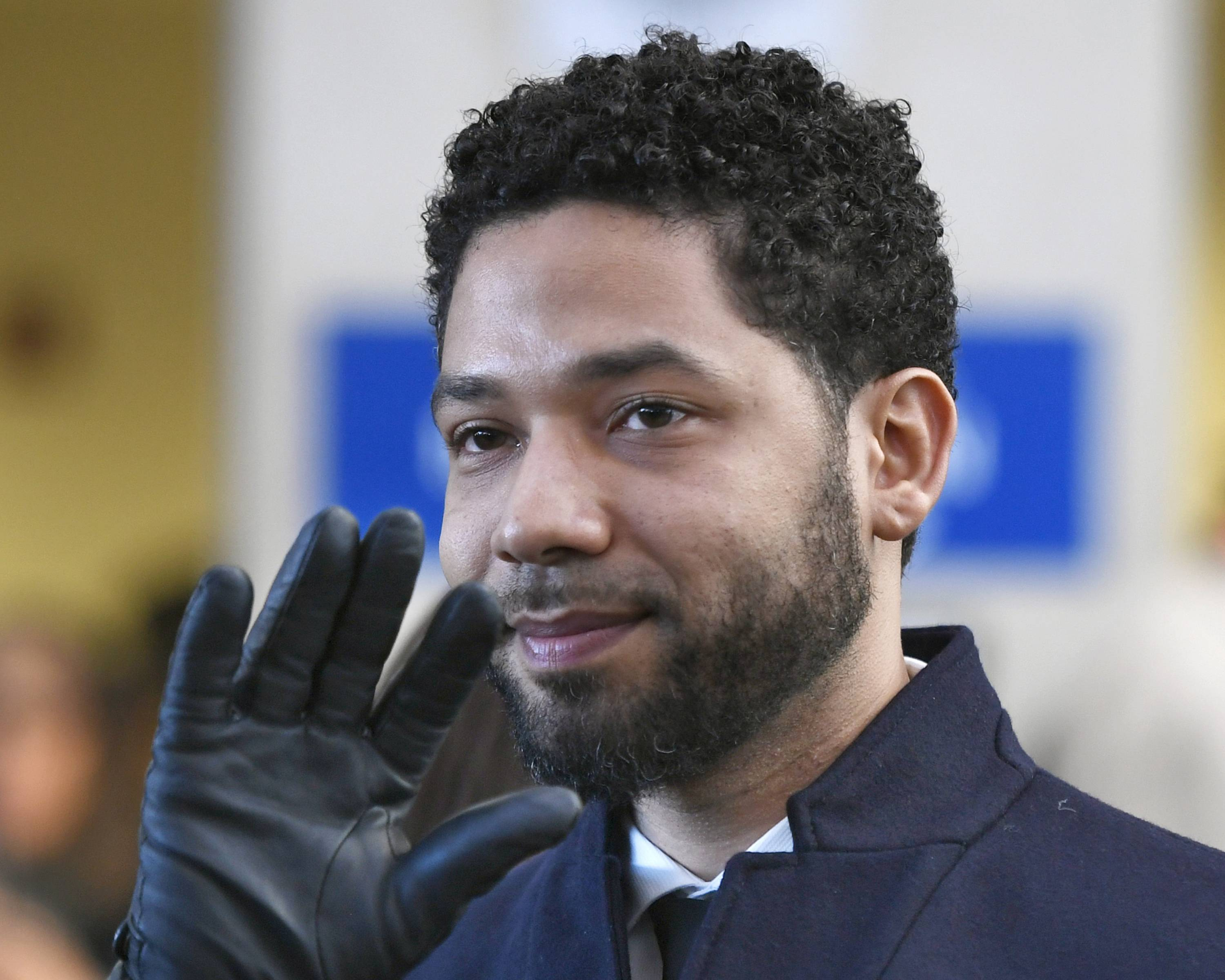 "Actor Jussie Smollett waves as he leaves Cook County Court after his charges were dropped in Chicago. A judge in Chicago has ordered the file in the Smollett criminal case unsealed. Cook County Judge Steven Watkins said Thursday that while there are good arguments in favor of keeping the file sealed, the ""Empire"" actor forfeited his rights to keep the case sealed to protect his privacy by talking to the media before and after prosecutors dismissed the charges against him."
